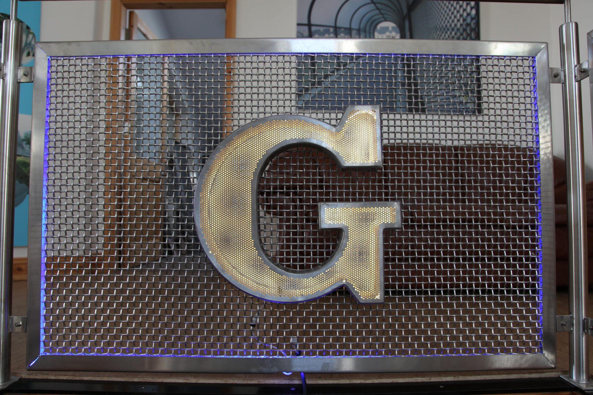 Outdoor branding metal signage graepel perforators